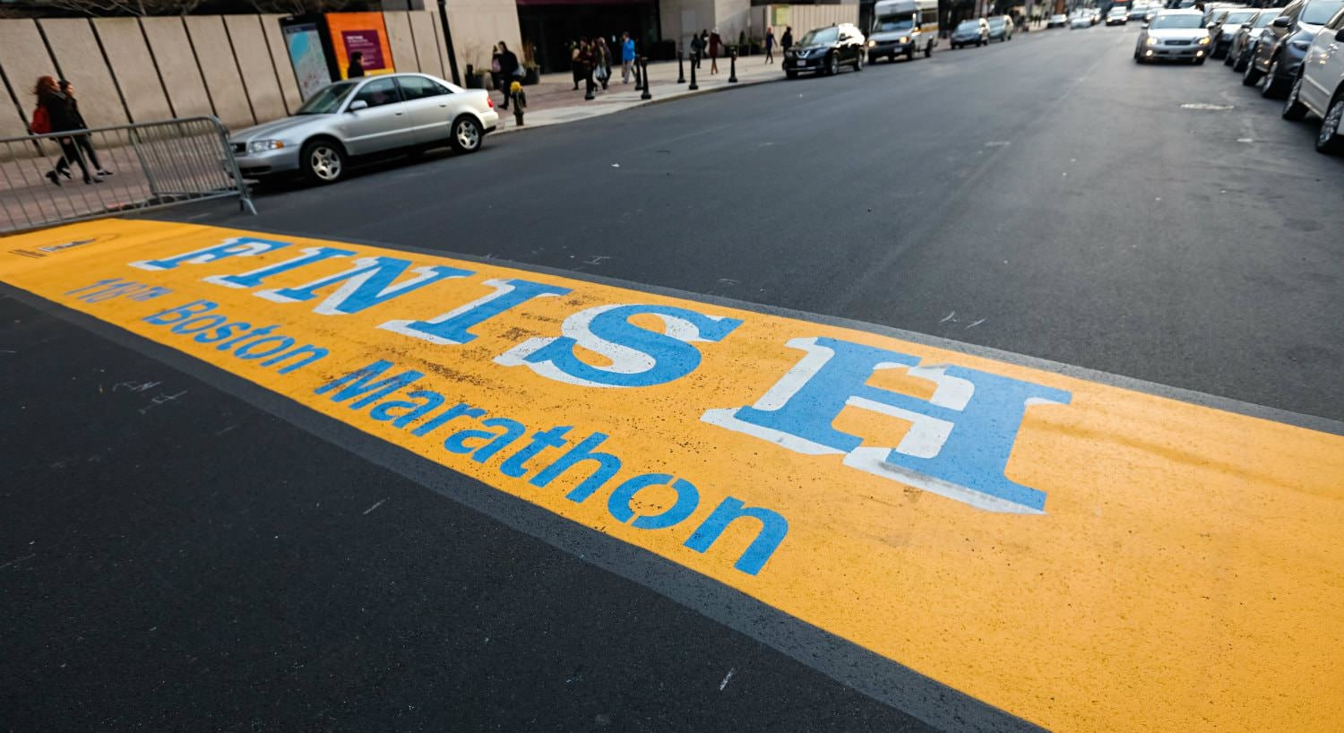 Yellow and blue painted Boston Marathon finish line on the street