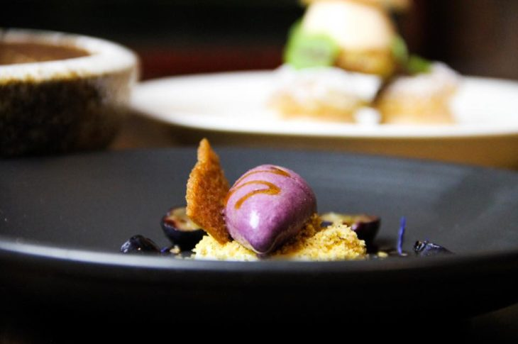 black bowl with purple ice cream and fried chip