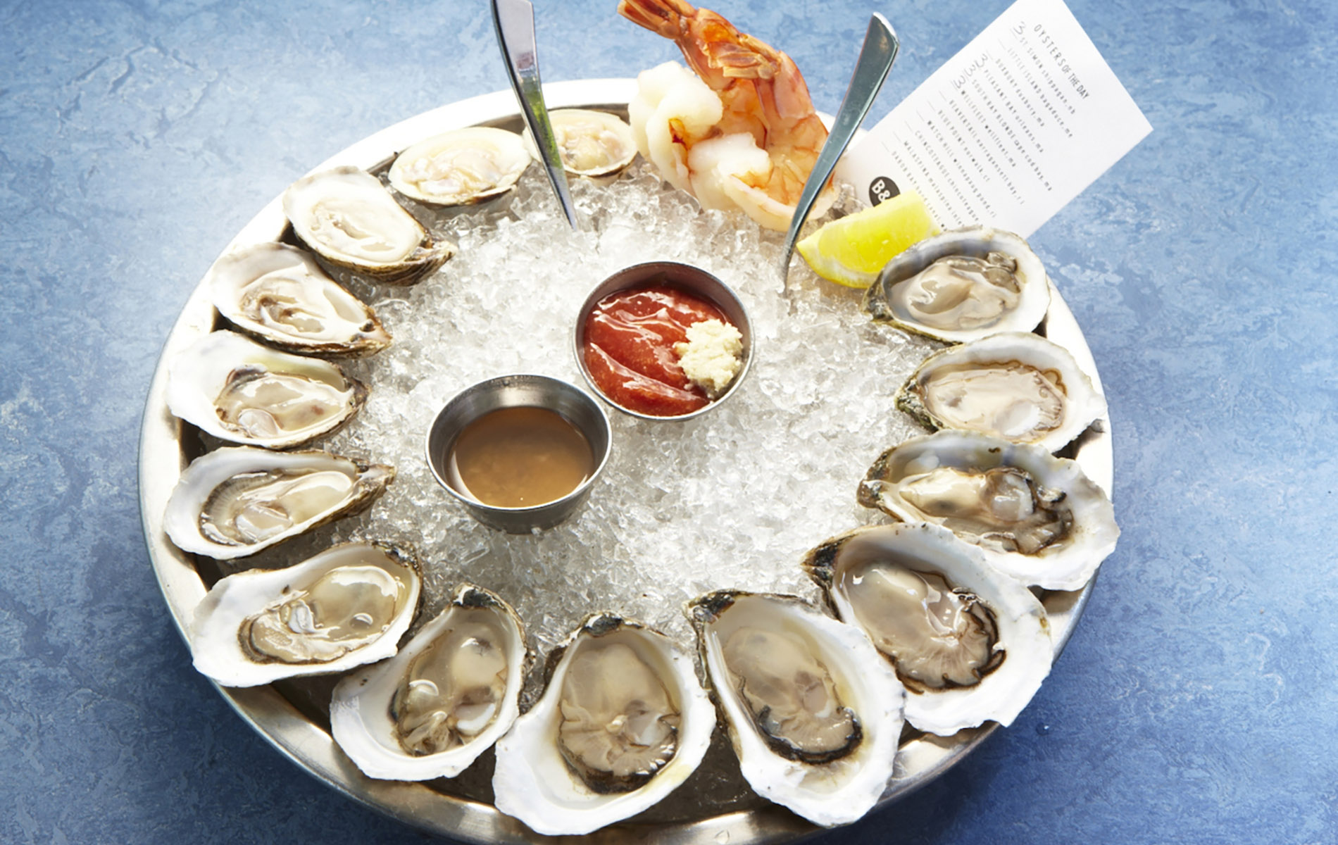 Blue background with oysters on ice