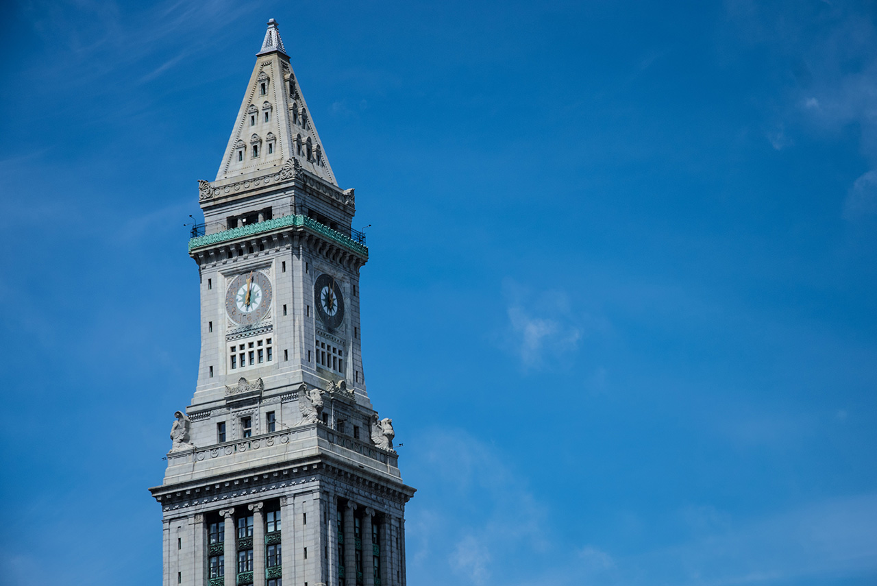 Stone 1800's clock tower with bright blue sky background