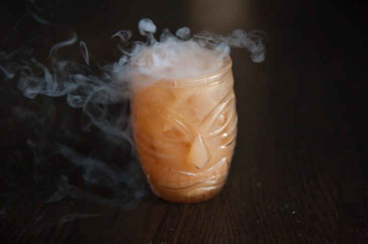 tiki orange cocktail with smoke