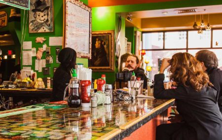 colorful bar top with green walls and a few people sitting