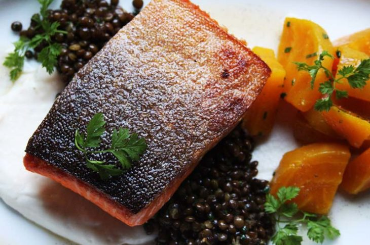 salmon with black caviar and orange potatoes