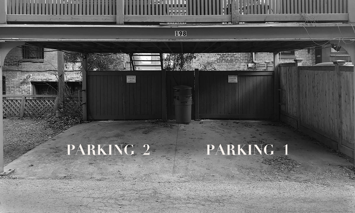 black and white photo of two parking spaces labeled partking 2 and parking 1