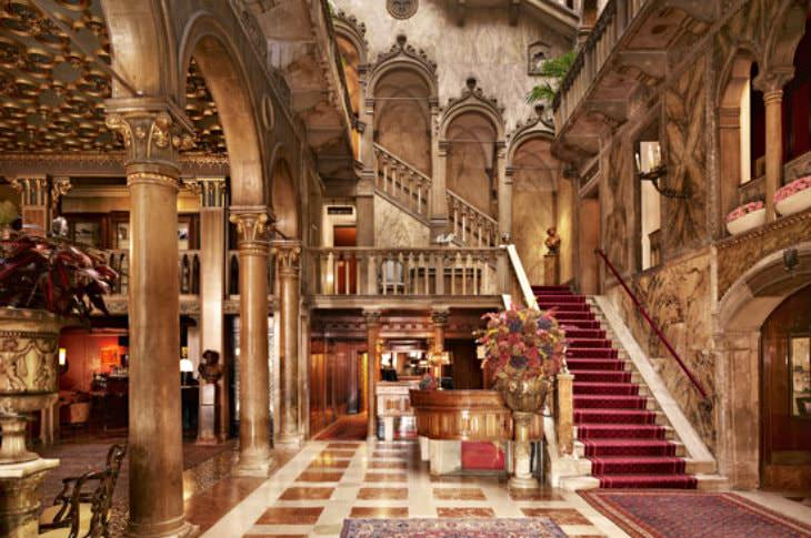 Extravagant hotel lobby in shades of gold and red with luxurious Italian design and decor
