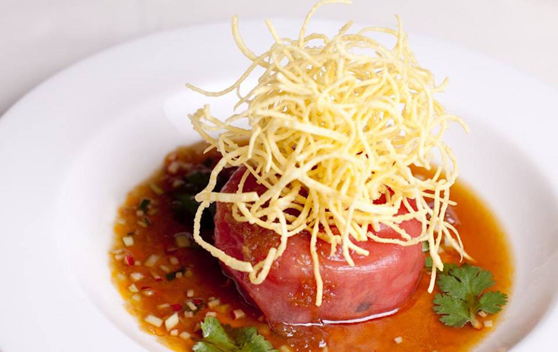 tuna tartare topped with fried onion in soy sauce