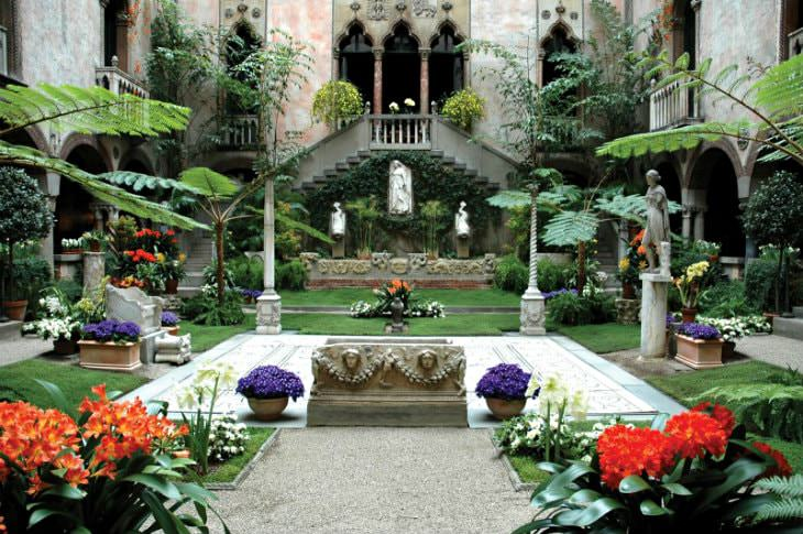 Lush green garden courtyard with red flowers
