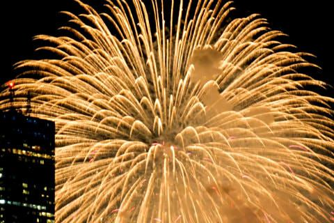 Large burst of gold fireworks against a black sky