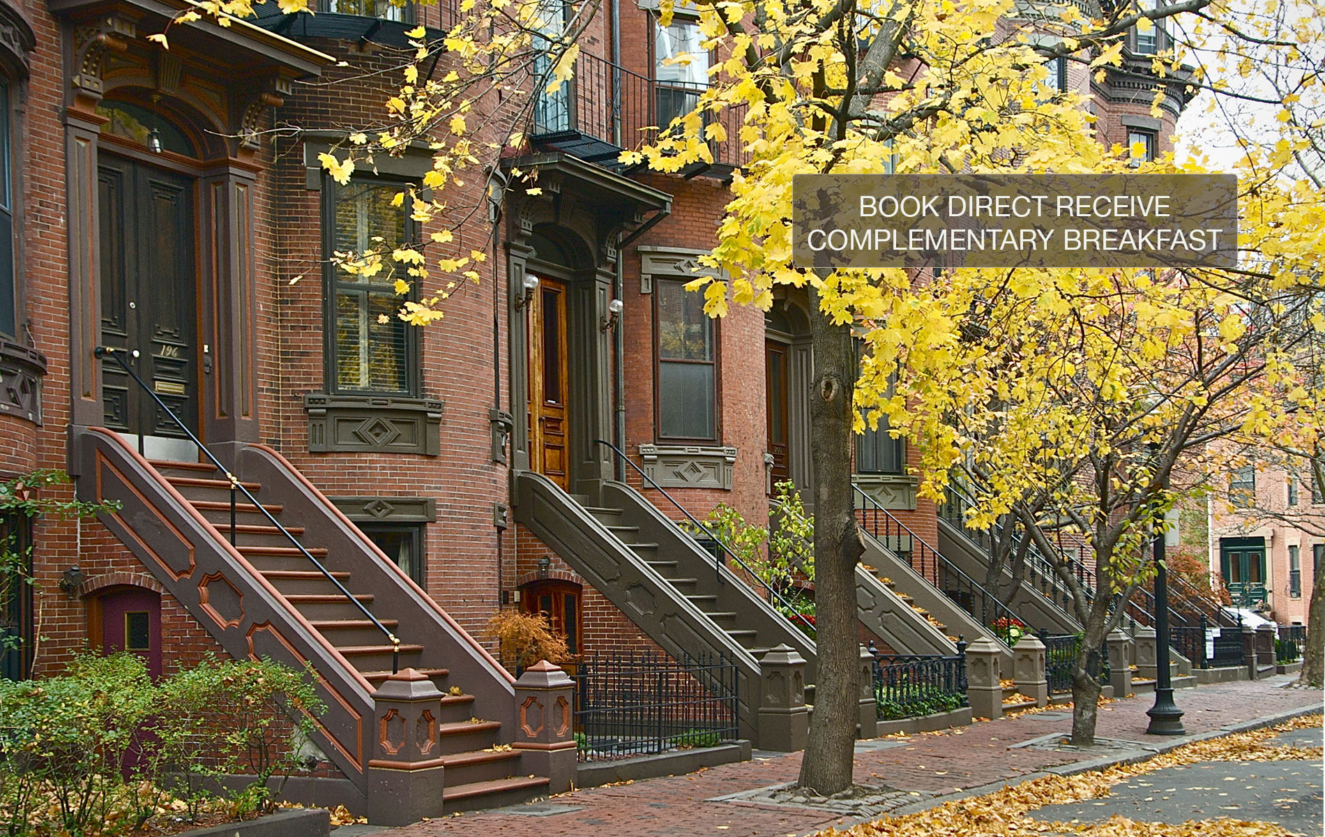 Red brick brownstone with stone staircase and large windows